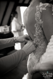 Wedding Preparation doing up the lace dress