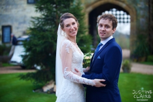 Portraits of bride and groom for winter wedding at Amberley castle in December with Xmas theme
