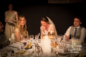 Speeches in black marquee at winter wedding in Amberley castle low light photography