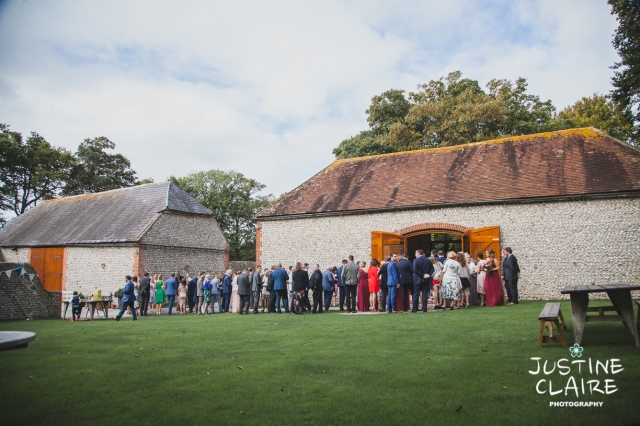 wedding photographer at Cissbury barn Findon Barn Venue Sussex reportage-44